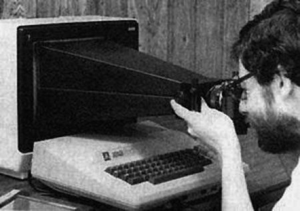 a man with a camera pointed at a screen